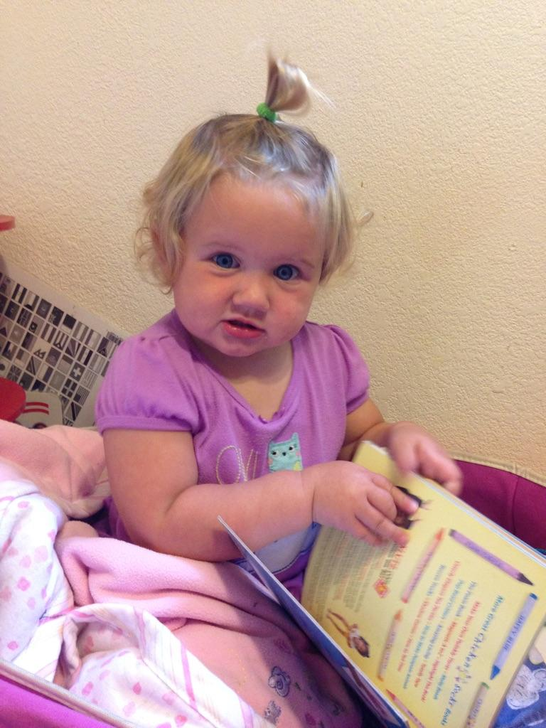 Little one loves to read